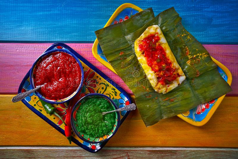 Tamale Mexican recipe with banana leaves royalty free stock image