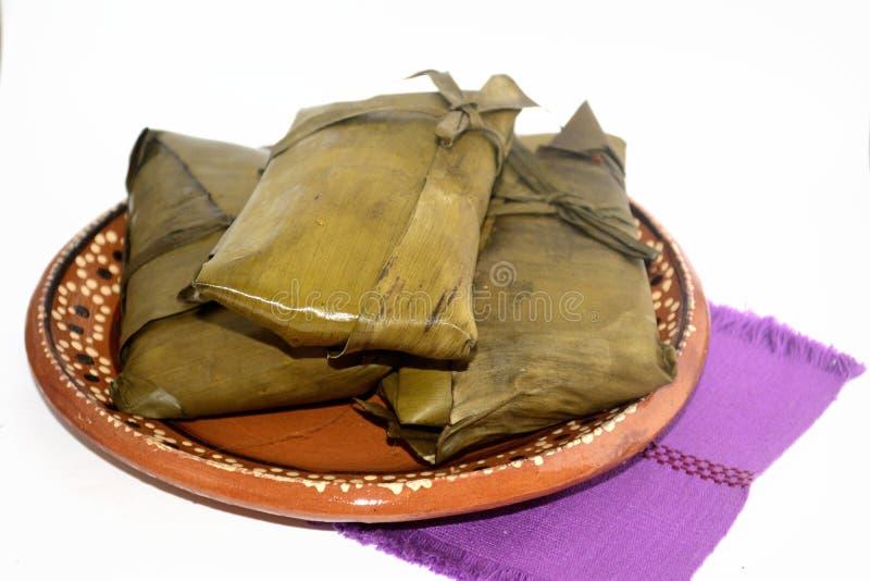 Tamales mexicanos tradicionales de los estados de Oaxaca y de Chiapas para la celebración de Candelaria Day fotografía de archivo