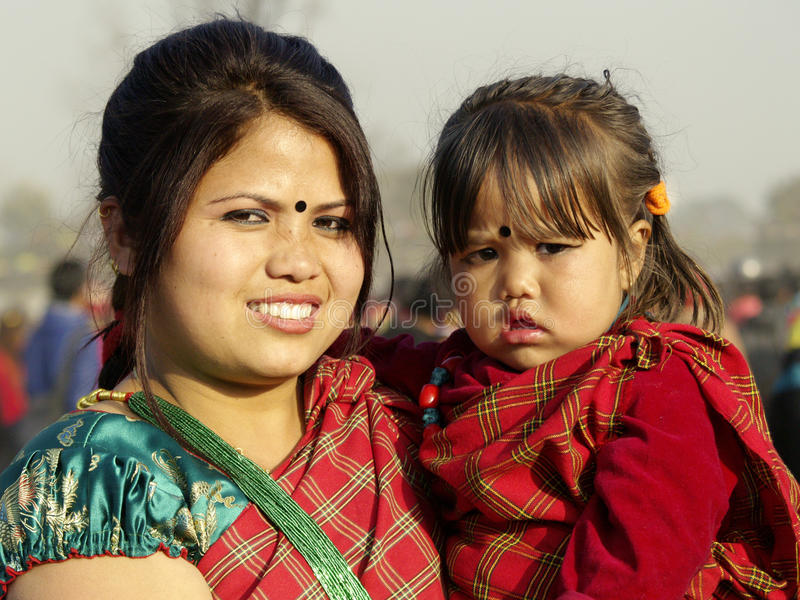 Tamang Mother and Daughter. Tamang community under the Mahayan sect of Buddhist religion, observed Sonam Lhosar across the nation this year on 24 January 2012 stock photo
