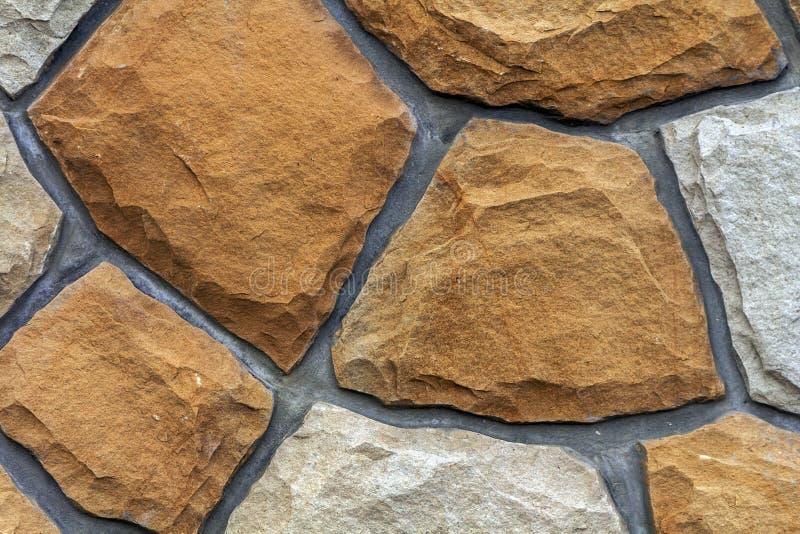 Tamanhos diferentes de pedras da areia Fundo do teste padrão da parede de pedra fotos de stock royalty free