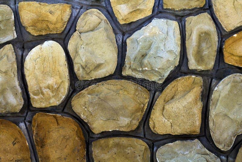 Tamanhos diferentes de pedras da areia Fundo do teste padrão da parede de pedra foto de stock royalty free