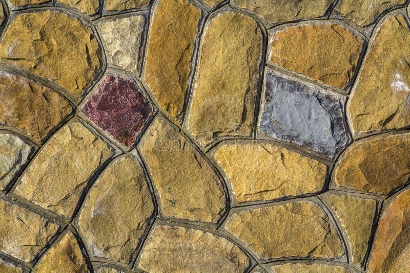Tamanhos diferentes de pedras da areia Fundo do teste padrão da parede de pedra imagens de stock royalty free