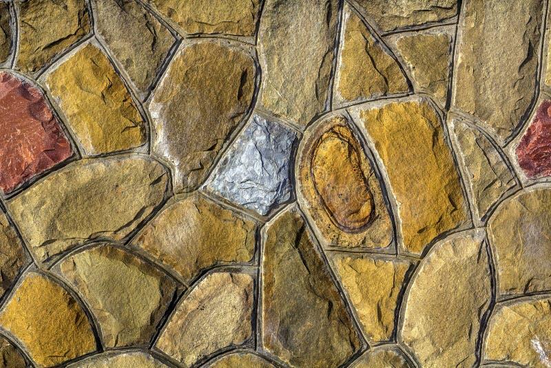 Tamanhos diferentes de pedras da areia Fundo do teste padrão da parede de pedra imagem de stock royalty free