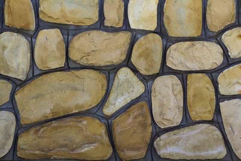 Tamanhos diferentes de pedras da areia Fundo do teste padrão da parede de pedra imagens de stock