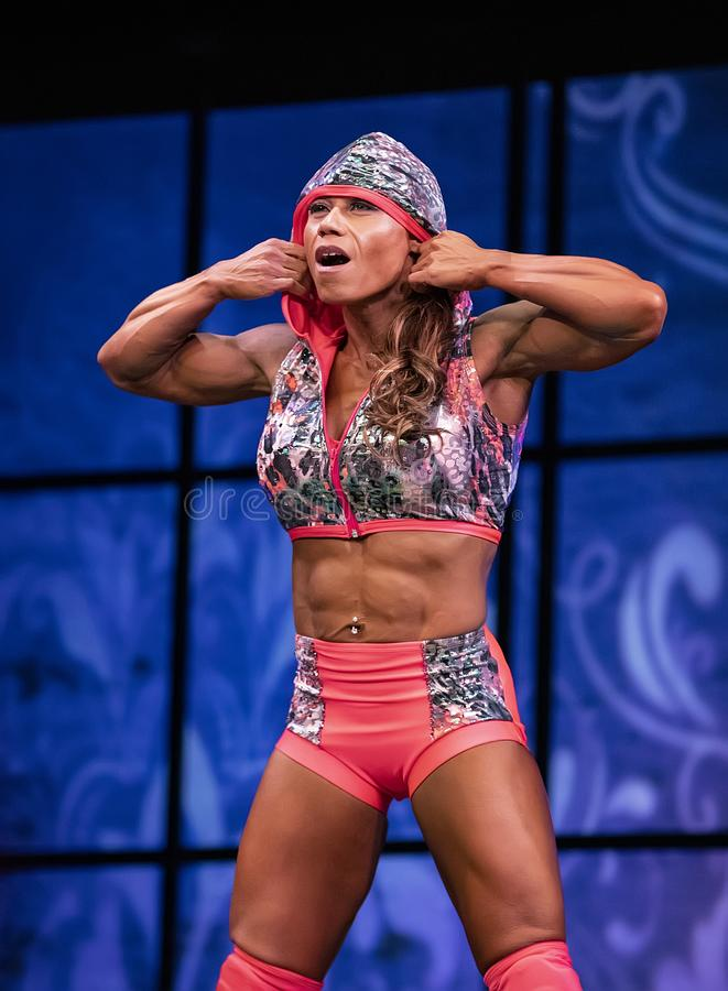 Fitness Performer at 2019 Toronto Pro Supershow. Tamara Vahn from Ontario, Canada, begins her stage performance before an appreciative audience at the women`s stock image