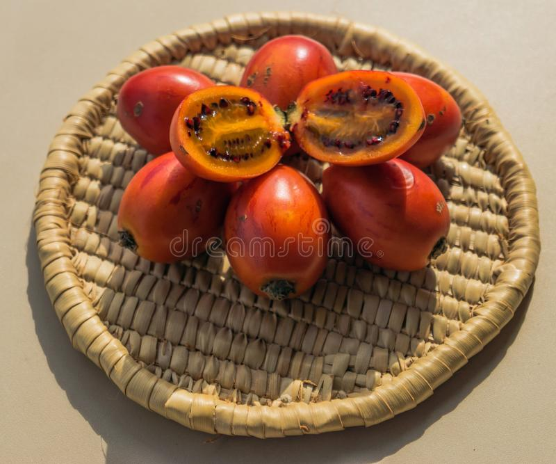 Tamarillo fruit on the basket. On the table stock photography