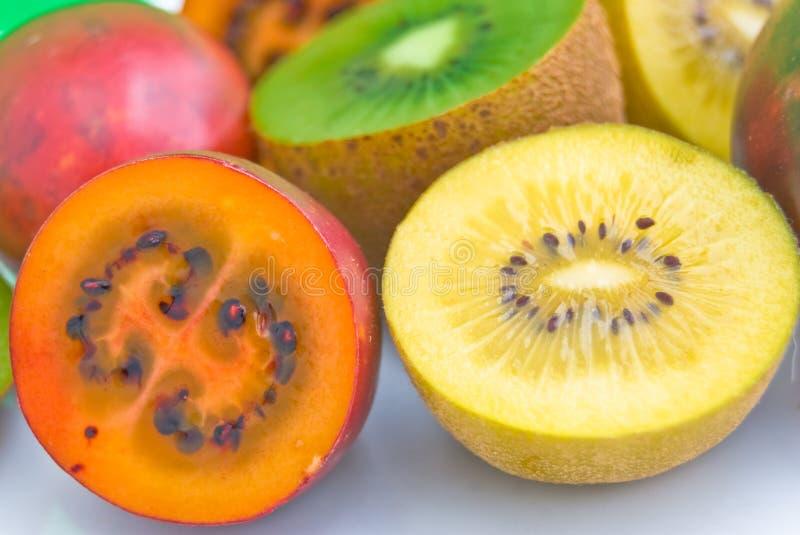 Tamarillo and golden Kiwi fruit royalty free stock image