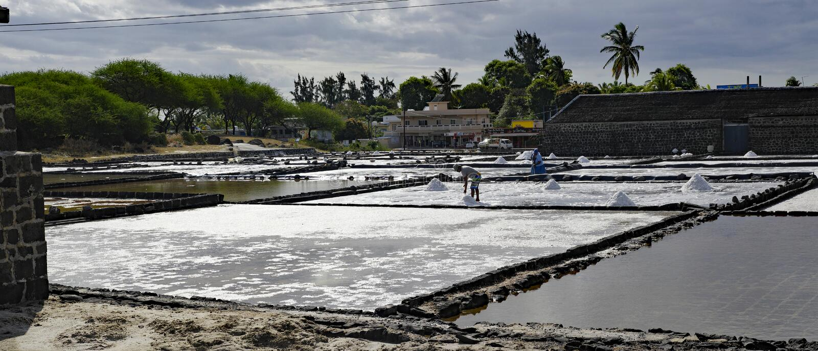 Tamarin Salt Pans is a popular tourist attraction with the square brick clay basins. Mauritius. TAMARIN/MAURITIUS - AUGUST 24, 2018: Tamarin Salt Pans is a royalty free stock photo