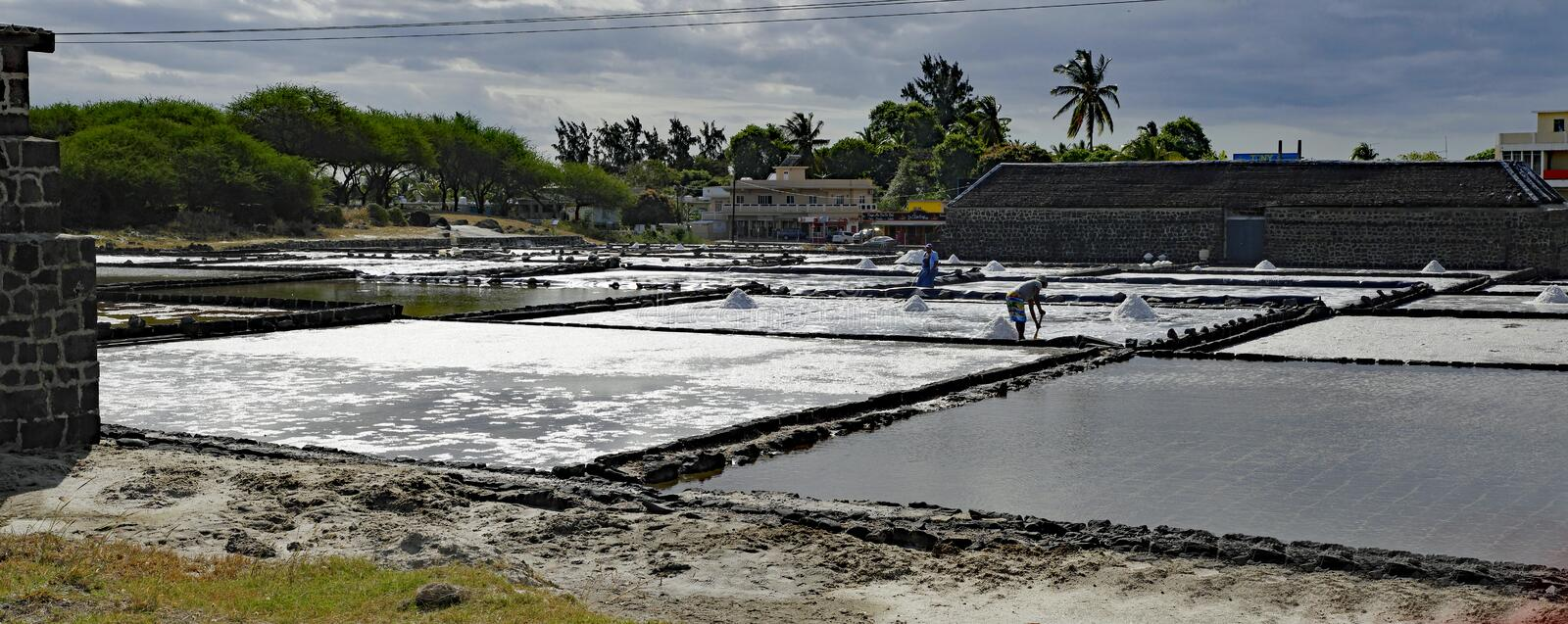 Tamarin Salt Pans. Mauritius. TAMARIN/MAURITIUS - AUGUST 24, 2018: Tamarin Salt Pans is a popular tourist attraction with the square brick clay basins.This place royalty free stock images