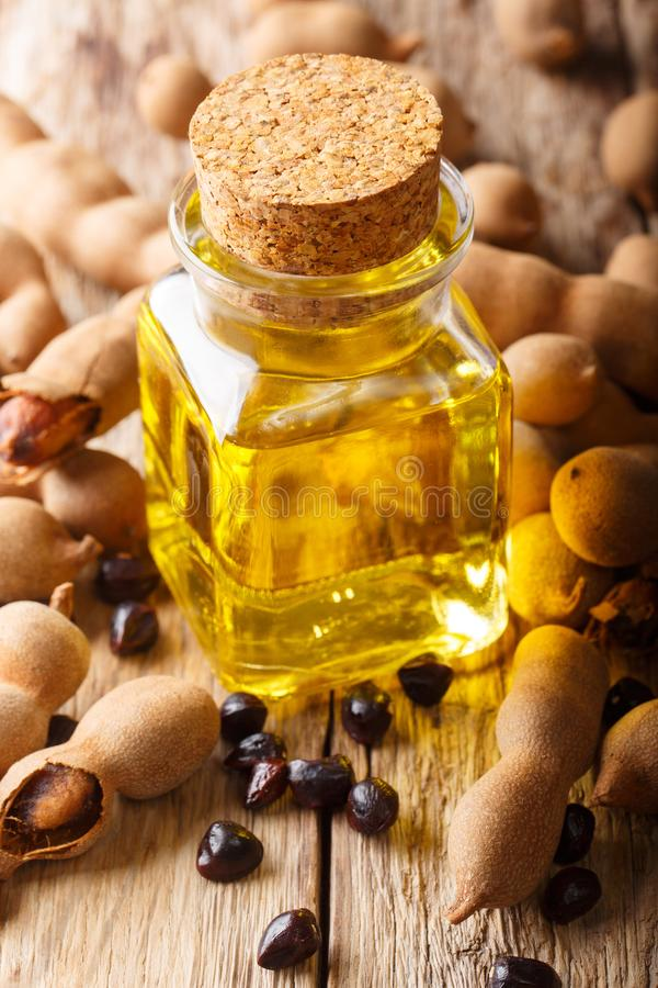 Tamarind Seed Oil, Ayurvedic Oil & Cosmetic Oils closeup and ingredients on a table. Vertical royalty free stock photos