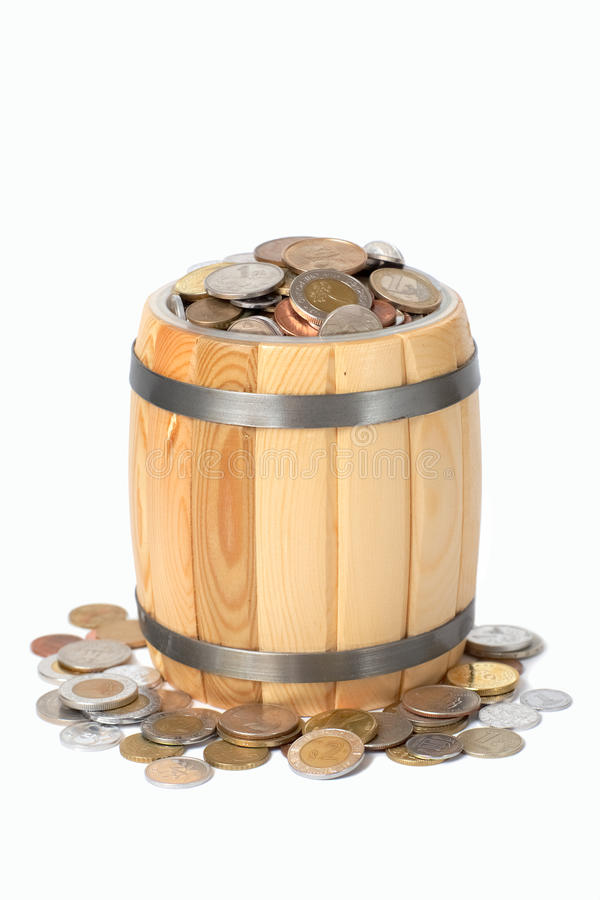 Tambor com várias moedas fotografia de stock
