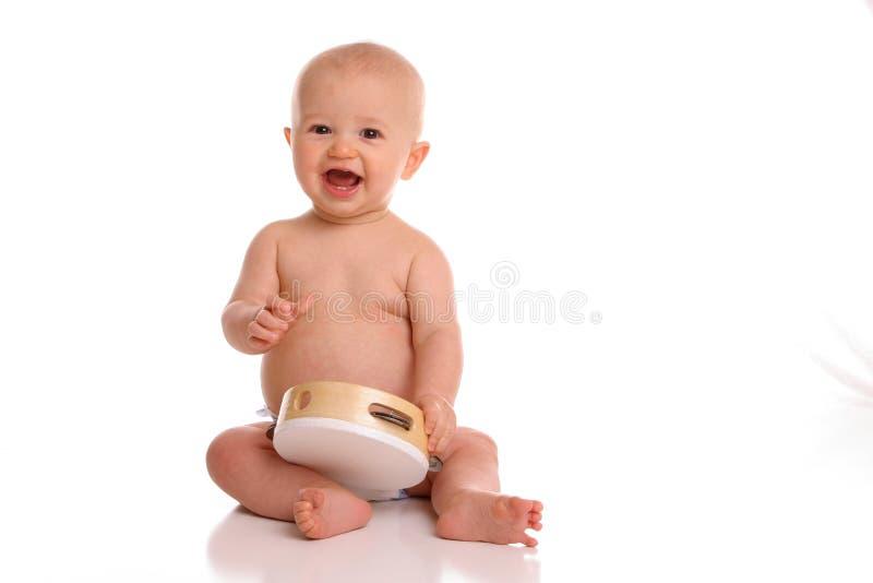 tamborine dziecko gracza zdjęcie stock