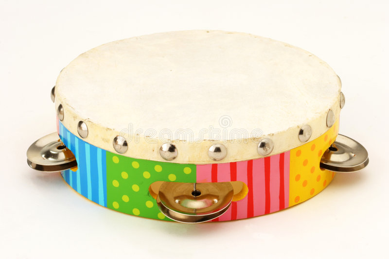 Tambourine. Multicolored toy tambourine with cymbals royalty free stock photo