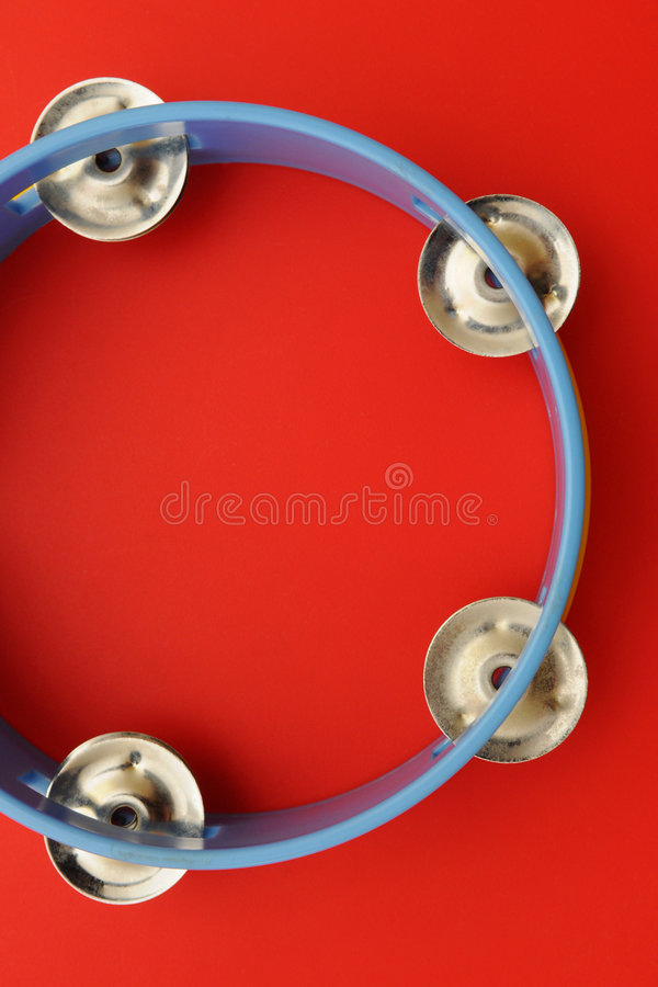 Tambourine. A blue tambourine on the red background royalty free stock image