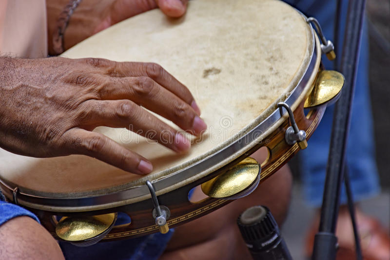 Tambourine being played by a ritimist. During a samba performance in Rio de Janeiro stock images