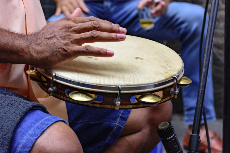 Tambourine being played by a ritimist. During a samba performance in Rio de Janeiro royalty free stock photo