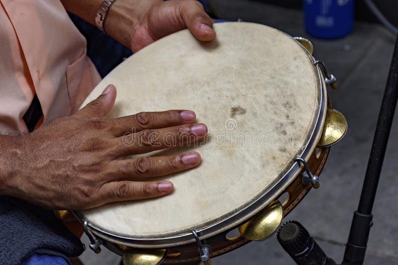 Tambourine being played by a ritimist. During a samba performance in Rio de Janeiro royalty free stock photos