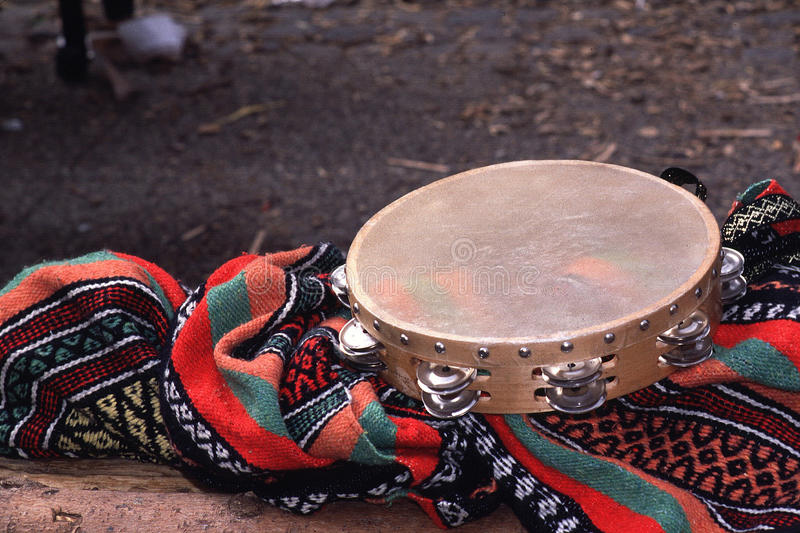 Tambourine. On a colorful blanket at a festival in Europe royalty free stock image