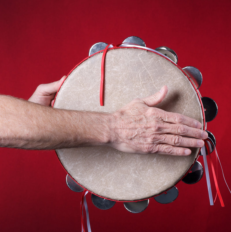 Tambourine jogado no vermelho fotos de stock