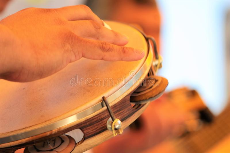 Tambourine ritimo striking. Pandeiro is the name given to some percussion musical instruments consisting of skin stretched in a frame rim. They are usually royalty free stock images