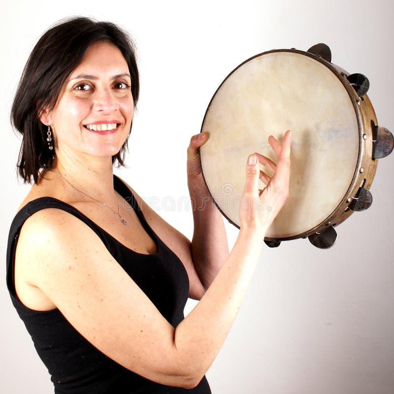Tambourine. Studio shot of a woman with tambourine stock photos