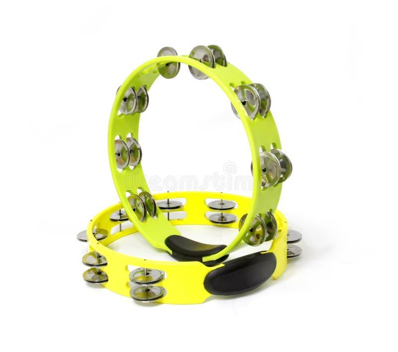 Tambourine. Yellow and green plastic tambourine on white background stock image