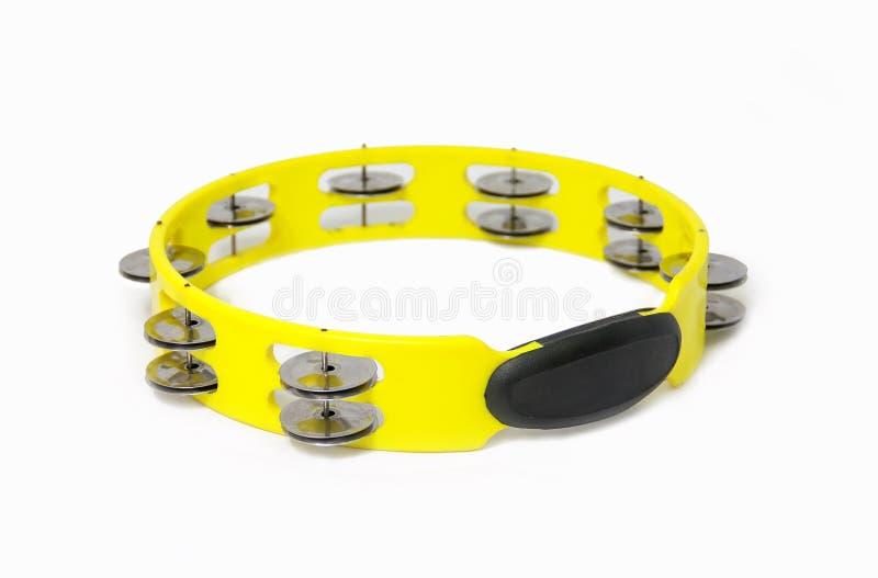 Tambourine. Yellow plastic tambourine on white background royalty free stock images