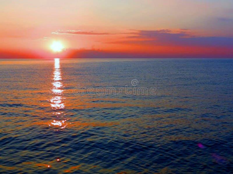 Tampão Córsega da ilha da praia do por do sol imagem de stock