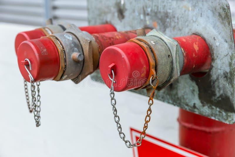 Tampão do close up da cabeça da boca de incêndio de fogo fotografia de stock