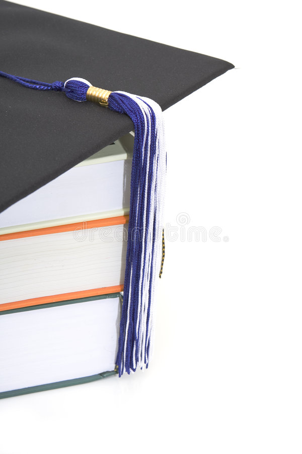 Tampão e livros da graduação imagens de stock