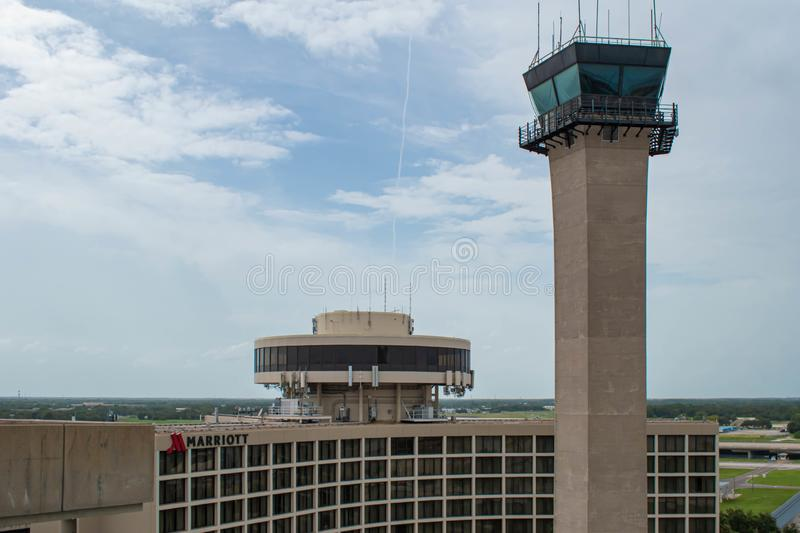 Tampa International Marriott and Air Traffic Control Tower at Tampa International Airport. Tampa Bay, Florida. July 12, 2019 Tampa International Marriott and Air stock image