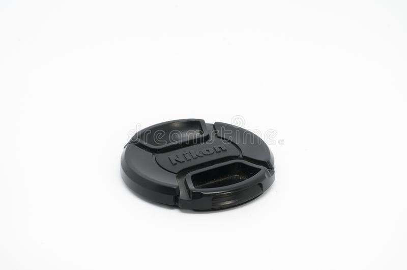 Tampa de lente do nikkor de Nikon isolada no fundo branco imagens de stock