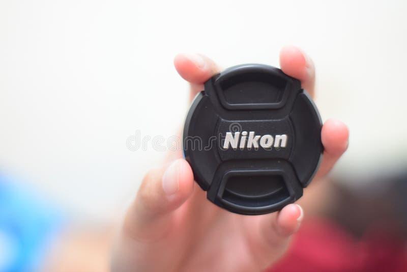 TAMPA DE LENTE DE NIKON imagens de stock