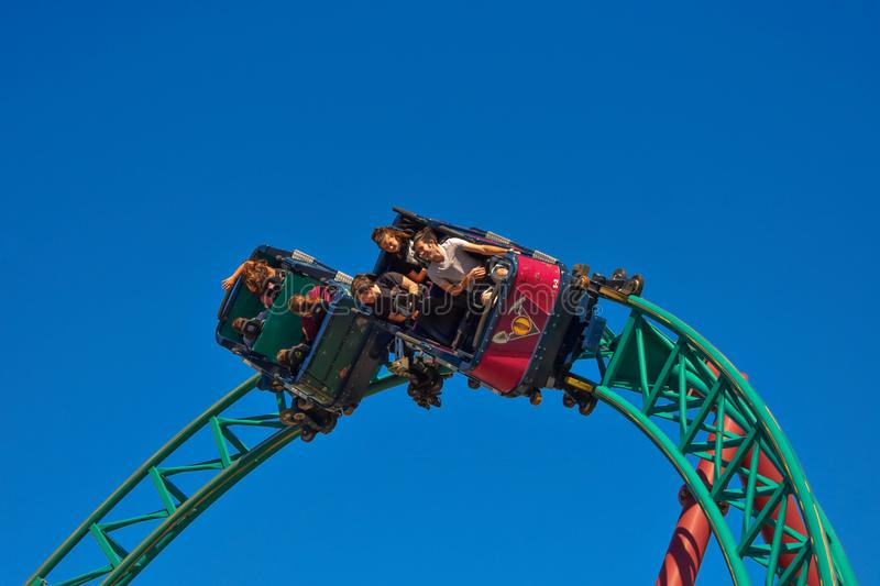 Funny people enjoying a spin in Cobra`s Hunt Roller Coaster at Bush Gardens Tampa Bay royalty free stock photography
