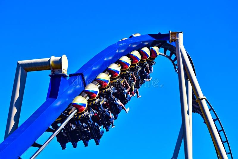 Funny people in seats of steel roller coaster trains climbing to a higher place on blue steel trail at Bush Gardens royalty free stock photography