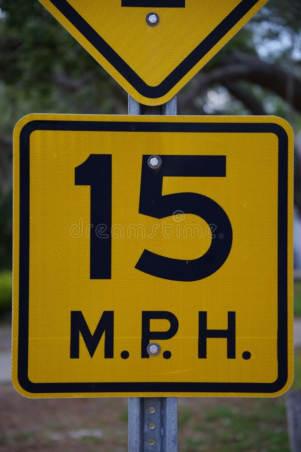 Tampa, Florida / USA - May 5 2018: 15 MPH low angle street sign stock photos