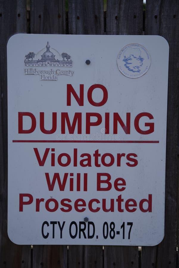 Violators Will Be Prosecuted For Dumping County Ordinance. Tampa, Florida / USA - May 5 2018: NO DUMPING, Violators Will Be Prosecuted County Ordinance stock photo