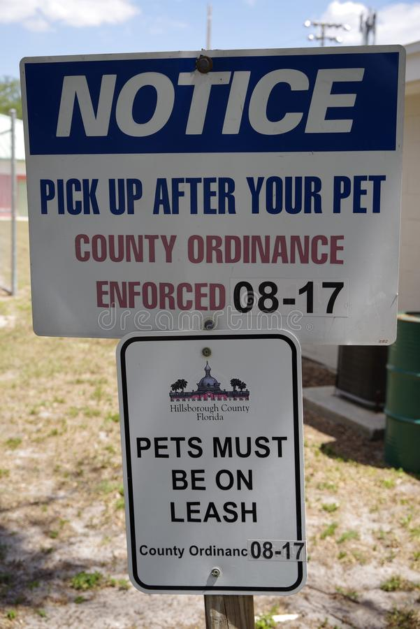 Public Pet Notice saying to pick up after your pet royalty free stock photos