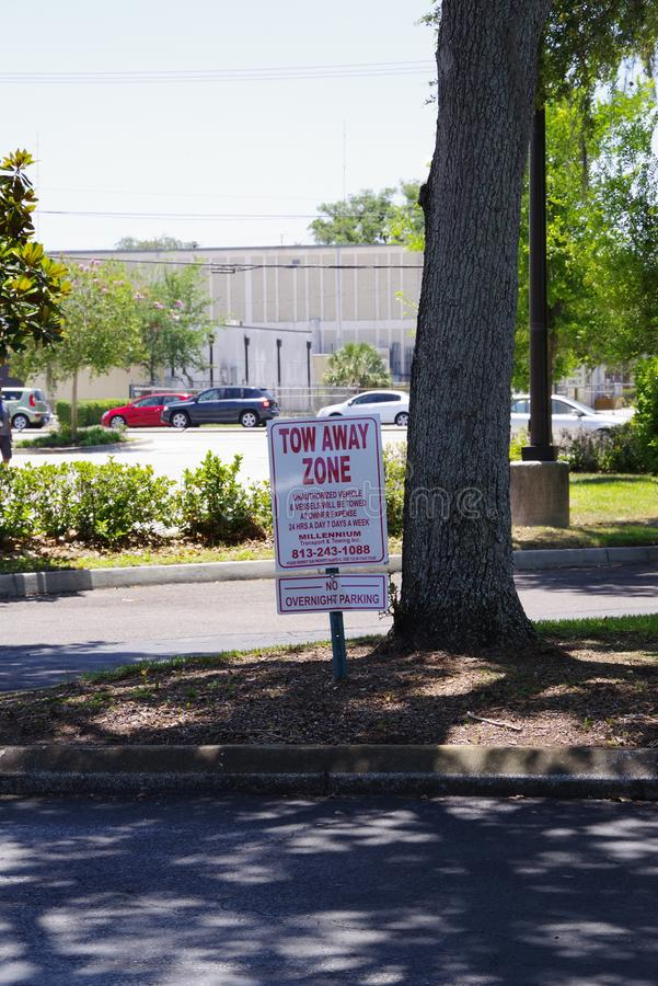 private street sign in public saying tow away zone royalty free stock images