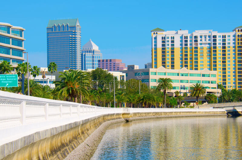 Tampa skyline viewed from Bayshore Blvd. Beautiful view of the Tampa skyline from Bayshore Boulevard with Tampa Bay water in the foreground stock images