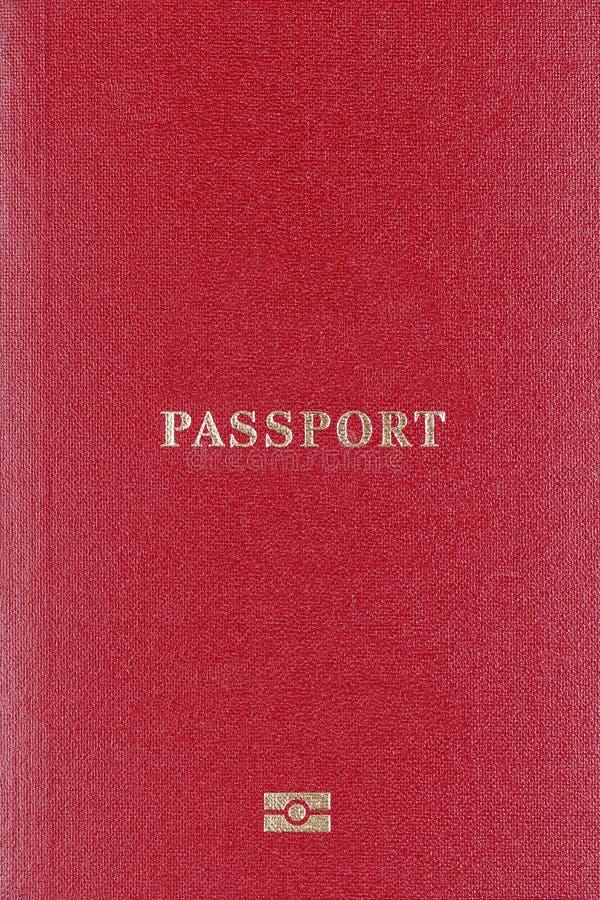 A tampa vermelha do close up do passaporte, placa fotos de stock