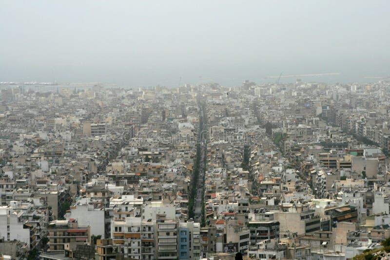 Tampas protetoras contra poeira de Atenas, Greece - de Sahara a cidade imagem de stock royalty free