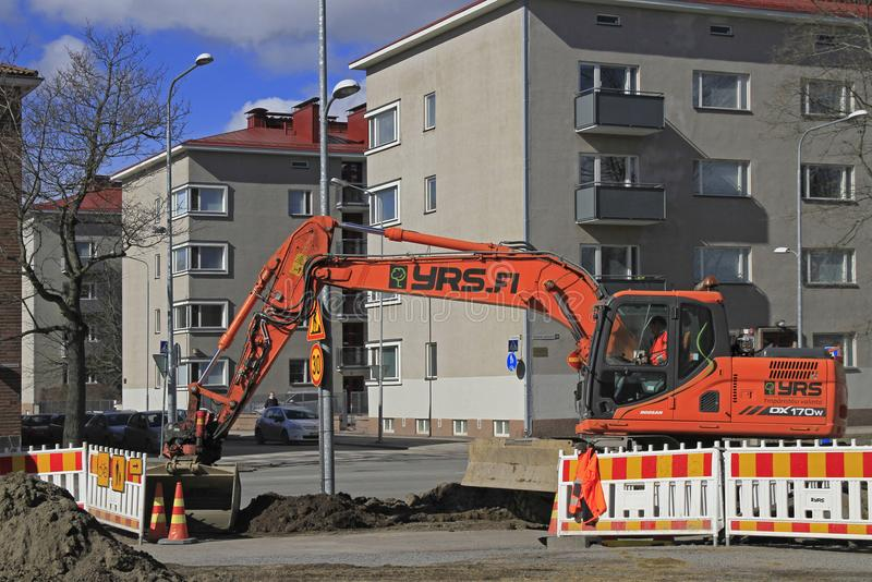 Excavator is digging the ground in Tampere. Tampere, Finland - April 7, 2017: man in excavator is digging the ground in Tampere, Finland royalty free stock images