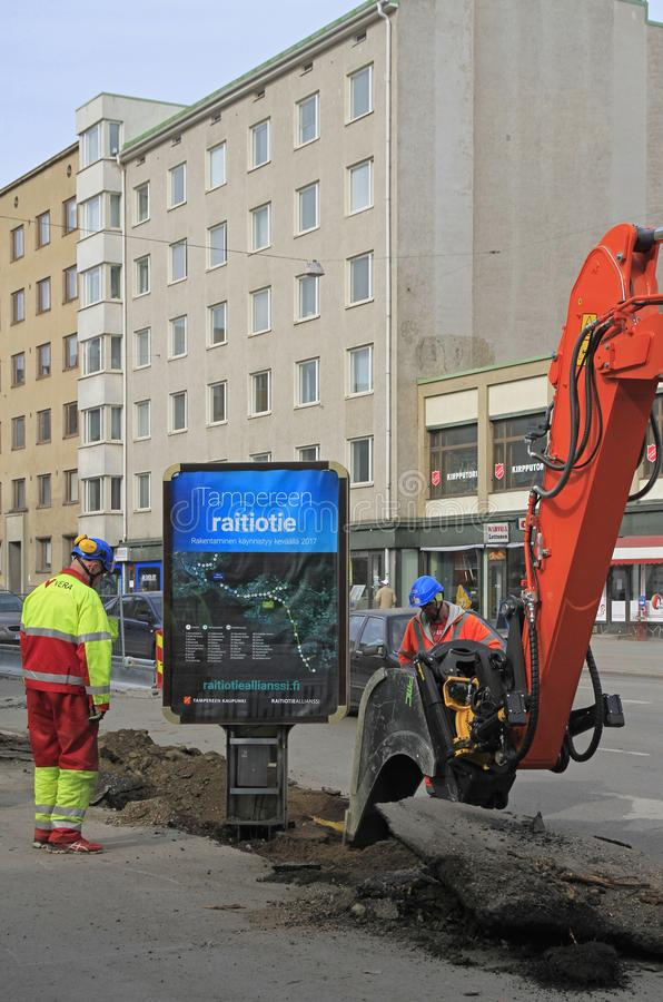 Excavator is digging the ground in Tampere. Tampere, Finland - April 8, 2017: man in excavator is digging the ground in Tampere, Finland royalty free stock photography