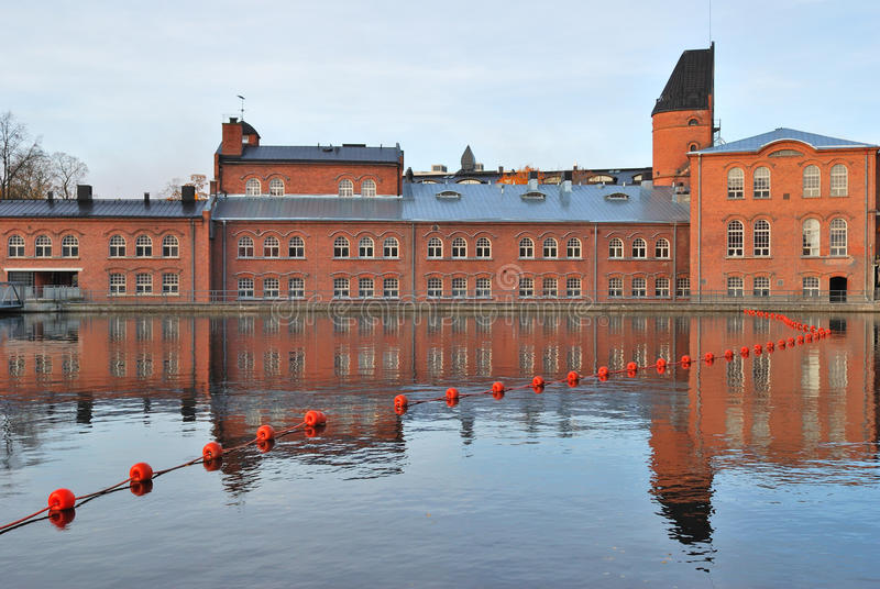 Tampere, Finland. Historic buildings on the banks of the river Tammerkoski stock images
