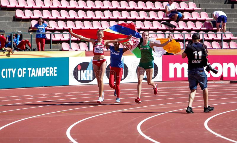 KARYNA TARANDA Belarus, MARÍA FERNANDA MURILLO Columbia, SOMMER LECKY Ireland - High jump winners on the IAAF World U20. TAMPERE, FINLAND, July 15: KARYNA royalty free stock photography