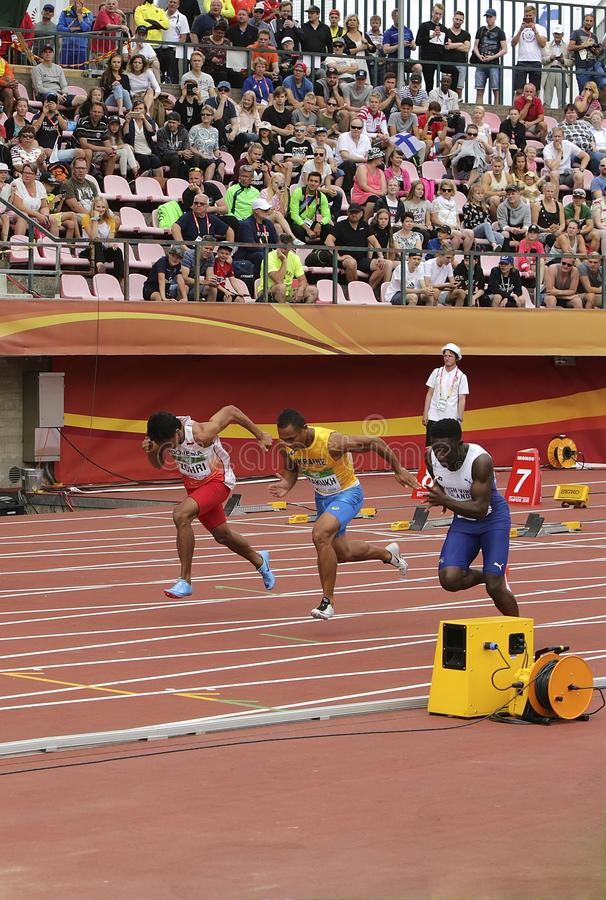 LALU MUHAMMAD ZOHRI Indonesia,VASYL MAKUKH Ukraine,RIKKOI BRATHWAITE IVB in 100 m. Semi-Final on. TAMPERE, FINLAND, July 11: LALU MUHAMMAD ZOHRI Indonesia,VASYL royalty free stock photography