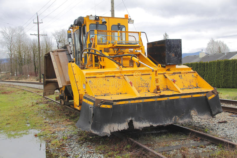 Tamping Machine or Ballast Tamper. Profile view of a tamping machine used to pack railway tracks to make them more durable royalty free stock image