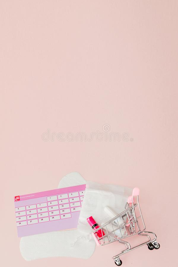 Tampon, feminine, sanitary pads for critical days, feminine calendar, pain pills during menstruation on a pink background. stock photos