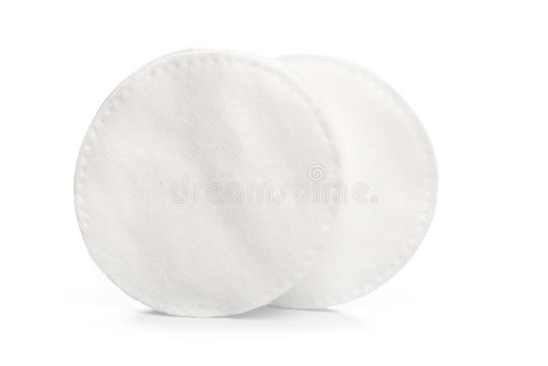 Tampons de coton d'isolement sur un fond blanc image stock